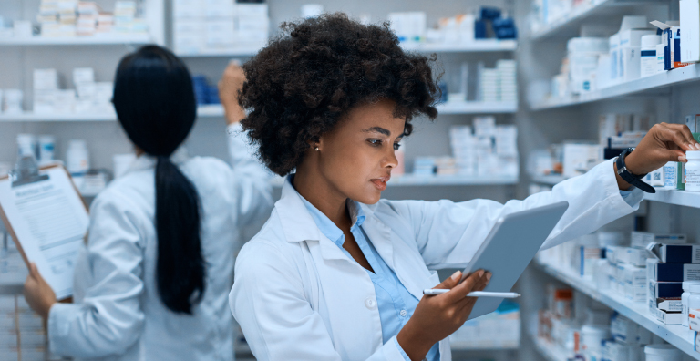 pharmacist reviewing prescription