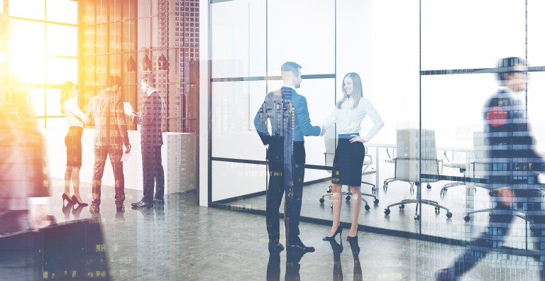 People standing in lobby of building