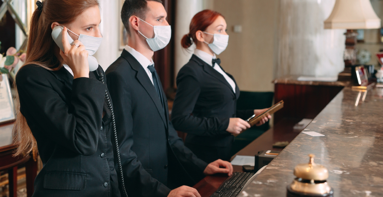 hotel receptionists wearing masks